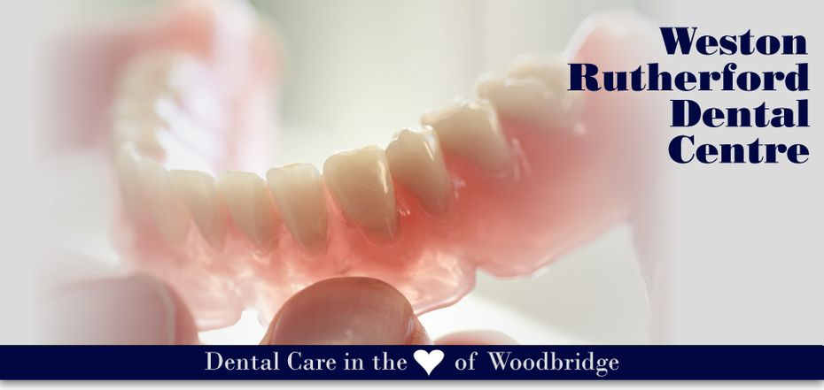 man holding dentures - Dental Care in the Heart of Woodbridge